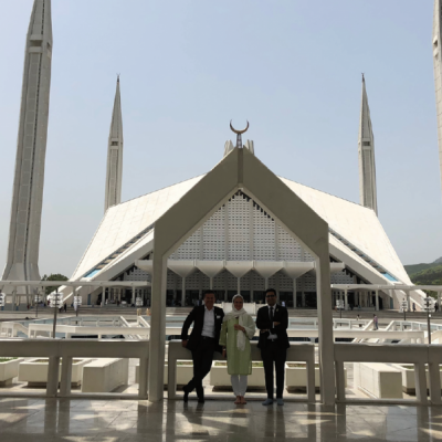 Bavarian Business Delegation to Pakistan, April 2019. The Faisal Mosque is located on the foothills of Margalla Hills in Islamabad, the mosque features a contemporary design consisting of eight sides of concrete shell and is inspired by a Bedouin tent. The mosque is a major tourist attraction, and is referred to as a contemporary and influential feature of Islamic architecture.